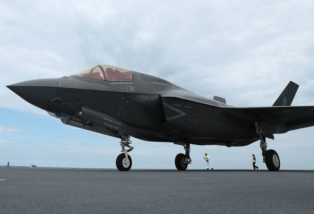 AT SEA - SEPTEMBER 27:  A new F-35B Lightning fighter jet is ready for take off from the deck of the United Kingdom's new aircraft carrier, The HMS Queen Elizabeth at sea in the Atlantic Ocean off the U.S. mid-Atlantic coast, on September 27, 2018. Two F35-B's are participating in flight trials aboard the carrier which is able to embark up to 24 of the supersonic jets.  (Photo by Mark Wilson/Getty Images)