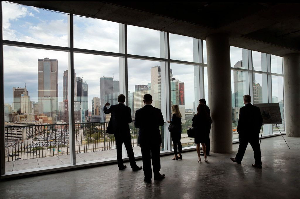 Uber executives and guests take in the Dallas skyline from the 12th floor of The Epic.