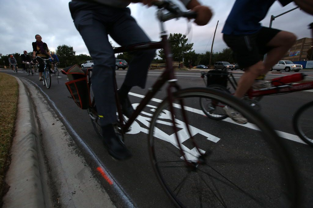 Cyclists ride in the bike lane at Zang and Colorado Boulevards in Oak Cliff. (Nathan Hunsinger/Staff Photographer)