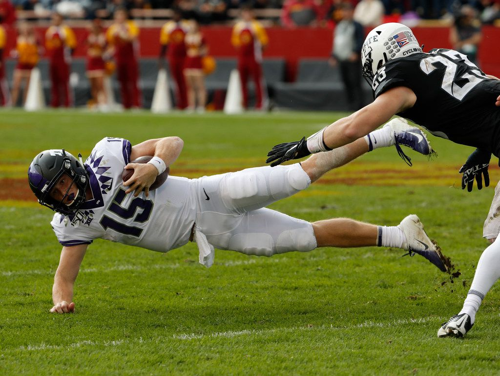 AMES, IA - OCTOBER 5: Linebacker Mike Rose #23 of the Iowa State Cyclones tackles quarterback Max Duggan #15 of the TCU Horned Frogs as he scrambled for yards in the second half of play at Jack Trice Stadium on October 5, 2019 in Ames, Iowa. The Iowa State Cyclones won 49-24 over the TCU Horned Frogs. (Photo by David Purdy/Getty Images)
