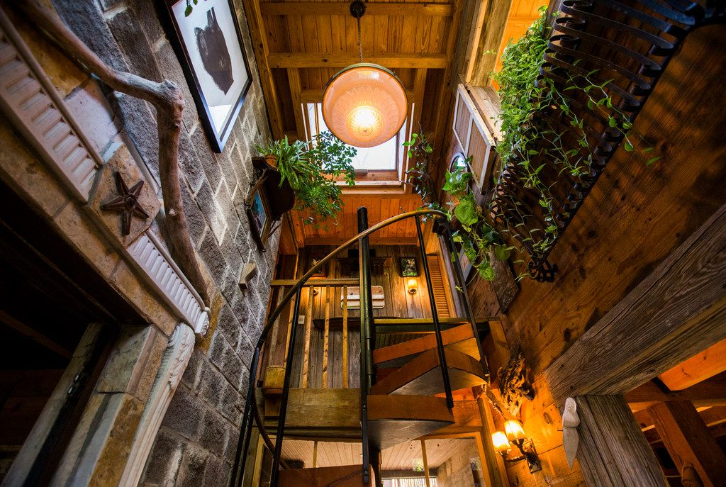 """The main entrance and staircase of an Airbnb house affectionately known as the """"tree house"""" and named the most wish-listed Airbnb in Dallas."""