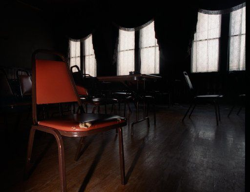 Chairs and tables in the second floor ballroom are said to be moved by the ghost of former caretaker Louis Barnhardt at the Sons of Hermann Hall.