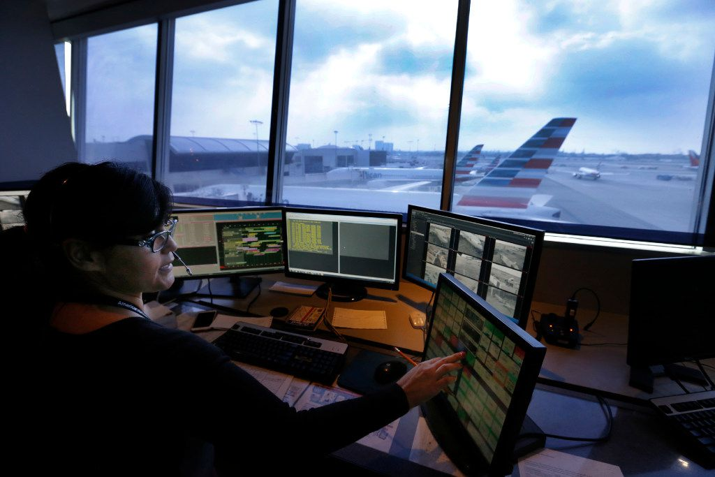 Airline Operation Control Center worker Anna Franco ensures an American Airlines Flight to Orlando Fla., gets to the runway safely at Los Angeles International Airport in Los Angeles in a 2016 file image. (Allen J. Schaben/Los Angeles Times/TNS)