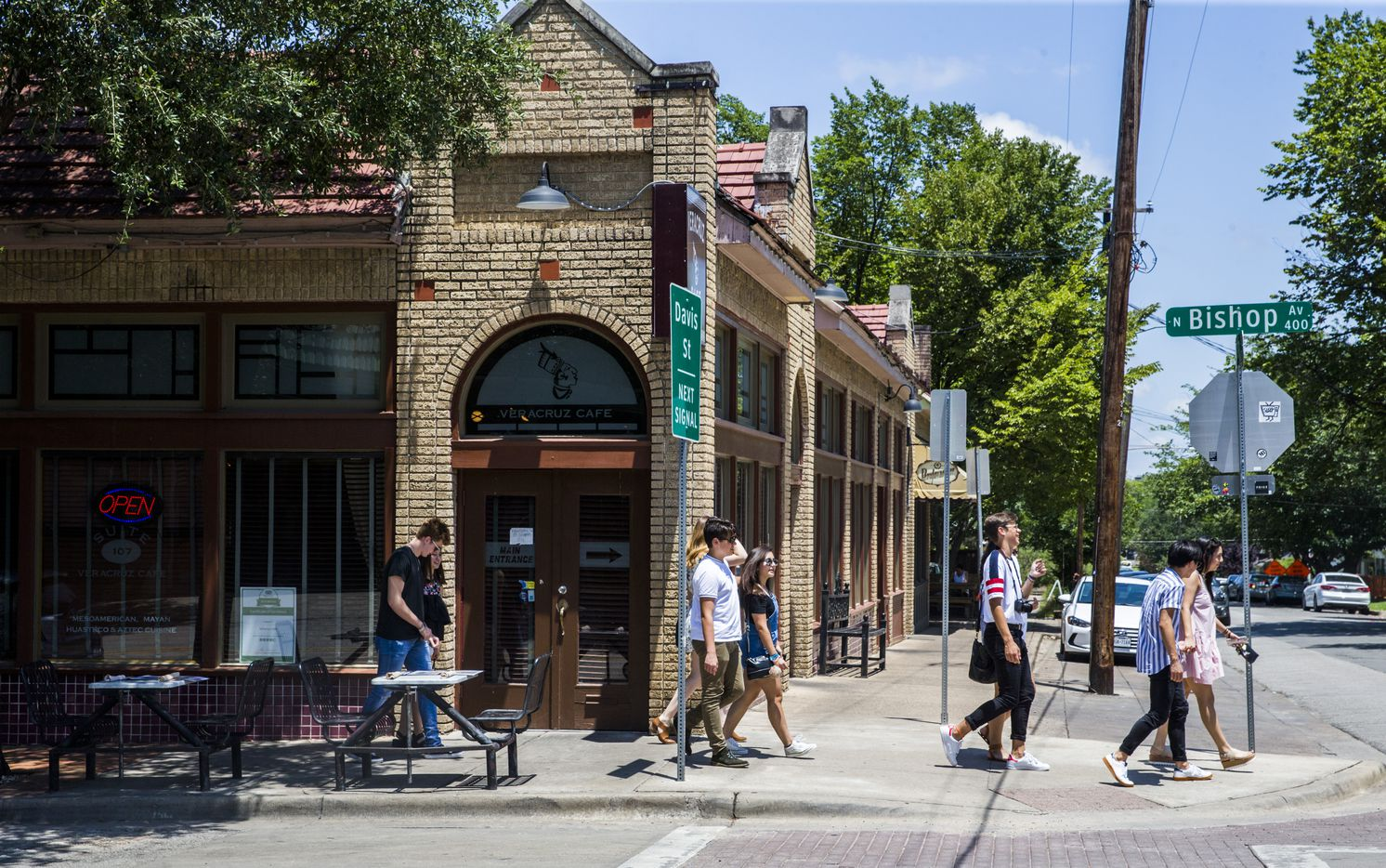 People walked among the shops and restaurants in the Bishop Arts District in June 2017.