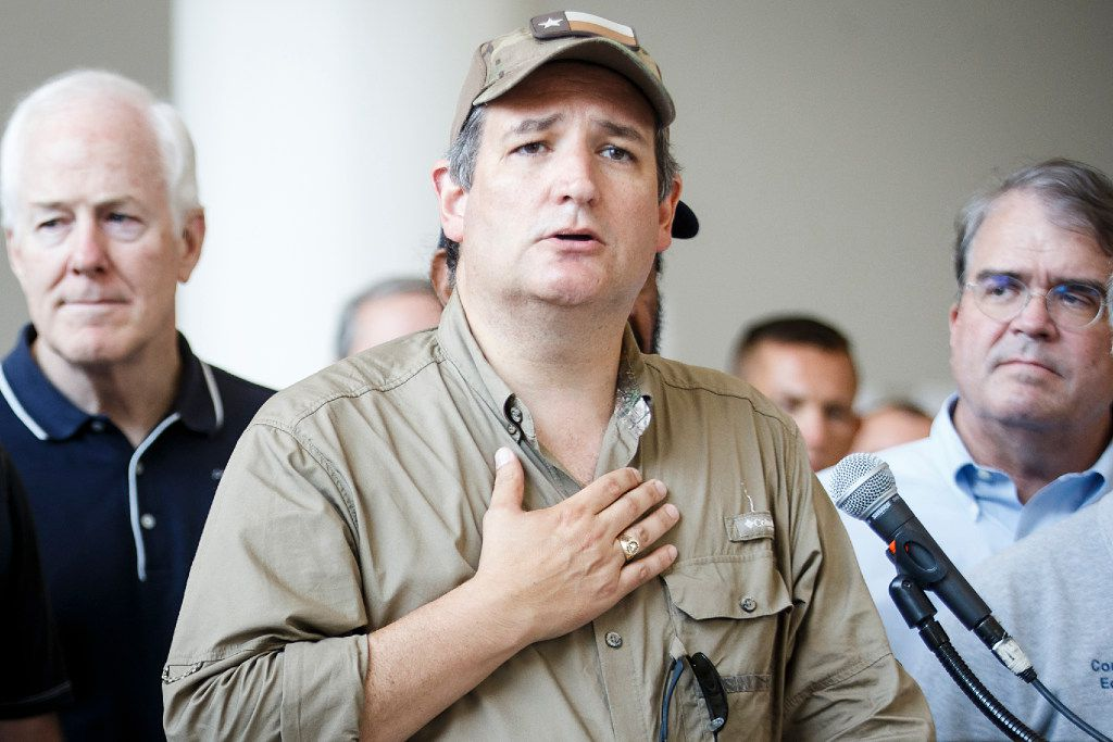 Sen. Ted Cruz is surrounded by fellow lawmakers and law enforcement as he addresses a press conference at the evacuation center at NRG Center on Sept. 4, 2017, in Houston. A group of elected officials met with evacuees and held a brief news conference to express support for emergency aid for Hurricane Harvey victims.