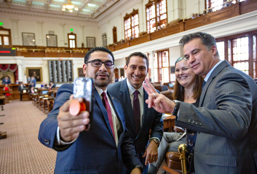 State Rep. Armando Walle, State Rep. Trey Martinez Fischer, State Rep. Michelle Beckley and State Rep. Roland Gutierrez interact with the livestream on Rep. Walle's phone while on the House floor just before Sine Die at the State Capitol of Texas on May 27, 2019 in Austin, Texas.