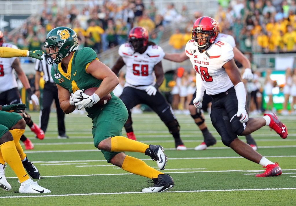WACO, TEXAS - OCTOBER 12: Clay Johnston #4 of the Baylor Bears is chased by Cameron Cantrell #18 of the Texas Tech Red Raiders after intercepting a tipped pass by the Texas Tech Red Raiders on October 12, 2019 in Waco, Texas.