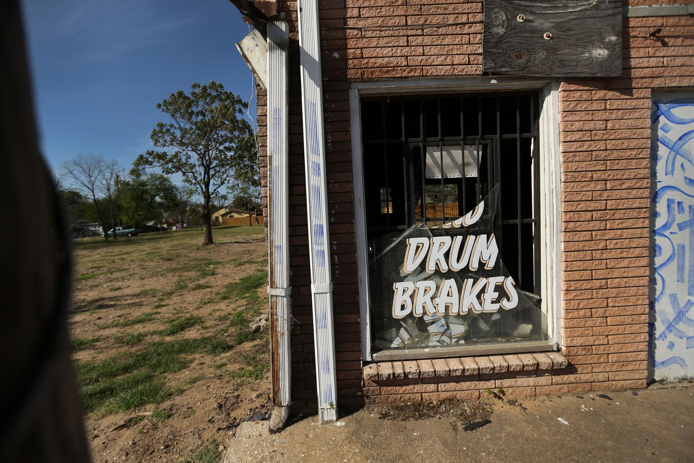 Welded bars over business doors on Singleton Ave, like this broken window from a former automotive shop, are commonplace in West Dallas near the Margaret Hunt Hill Bridge, Thursday, March 23, 2017. (Tom Fox/The Dallas Morning News)