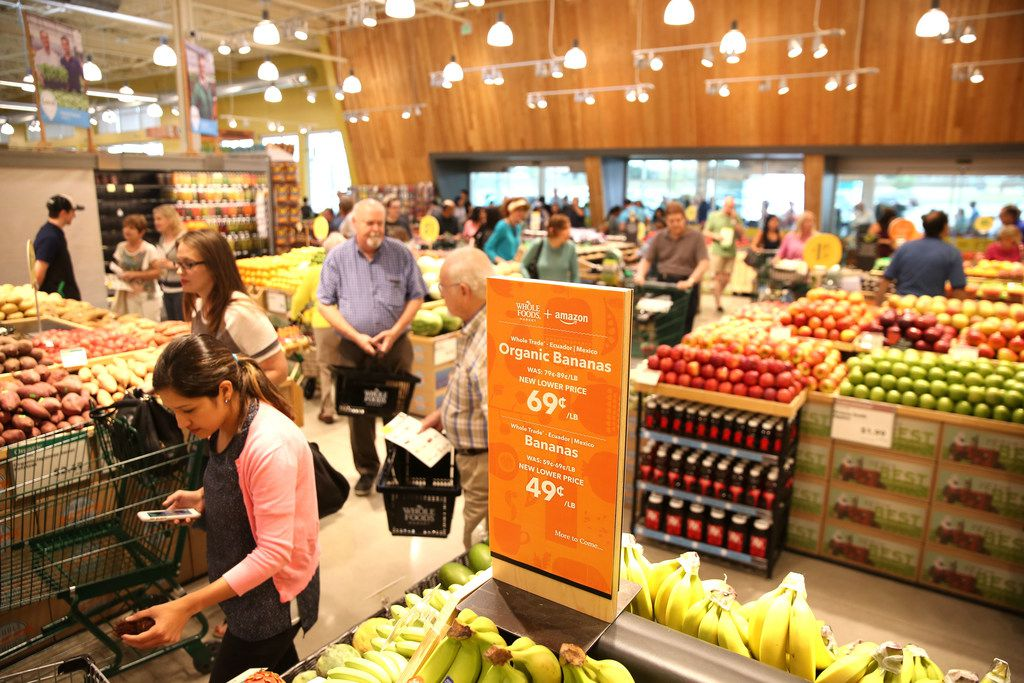A sign stating the lower price of bananas during a pre-shopping event at the new Whole Foods Market in Irving, Texas on Sept. 26, 3017. The store's grand opening was Sept. 28, 2017. (Rose Baca/The Dallas Morning News)