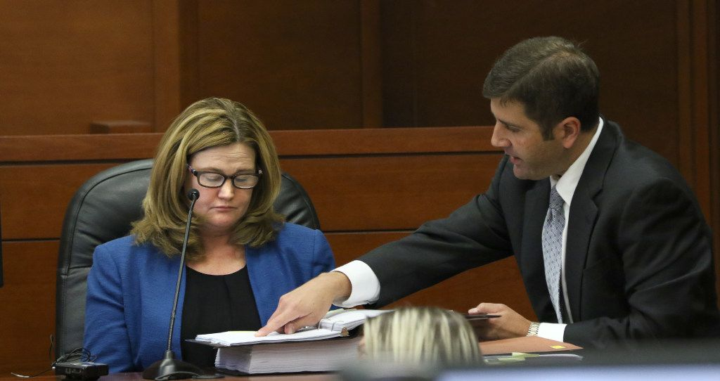 Executive Director Kelly Gottschalk is shown evidence by plaintiff's attorney Chris Ayres during the temporary injunction hearing to determine whether the Dallas Police and Fire Pension System can have an election to cut its benefits at the George L. Allen Civil Court Building in the 95th Judicial Court in Dallas on December 1, 2016. (Nathan Hunsinger/The Dallas Morning News)