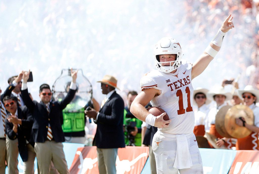 FILE - Texas quarterback Sam Ehlinger (11) celebrates a touchdown during the second half of the Red River Showdown against Oklahoma at the Cotton Bowl in Dallas on Saturday, Oct. 6, 2018. Texas beat Oklahoma 48-45. (Vernon Bryant/The Dallas Morning News