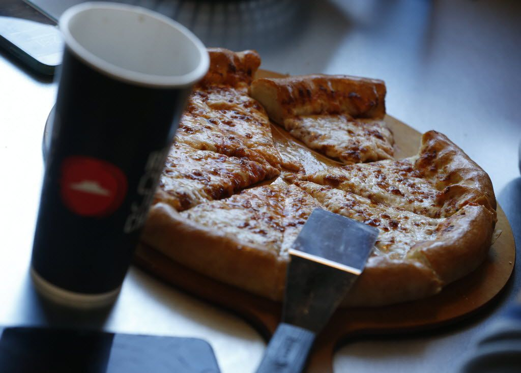 A piece of pizza at Pizza Hut in Lantana, Texas December 17, 2015. (Nathan Hunsinger The Dallas Morning News)