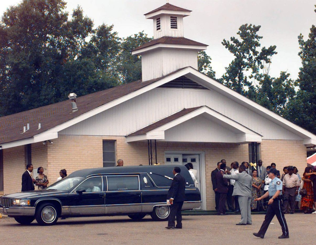 Mourners wait to enter the Greater New Bethel Baptist Church for the funeral service of James Byrd Jr. Saturday, June 13, 1998, in Jasper, Texas. Byrd, 49, was savagely beaten, then shackled by his ankles to the back of the truck and dragged to death along a rural East Texas road