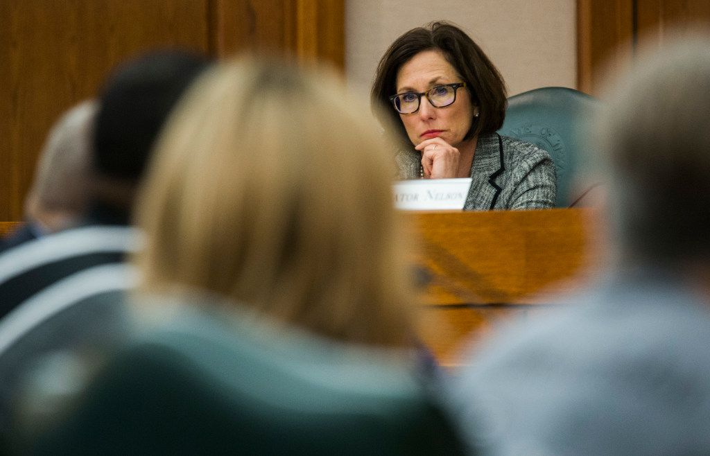 Senator Lois Kolkhorst, author of SB3, otherwise known as the bathroom bill, listens as people voice their opinions at a public hearing on the fourth day of a special legislative session on Friday, July 21, 2017 at the Texas state capitol in Austin, Texas.