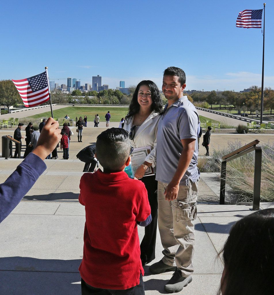 Norma Varela of Mexico poses for a photo with husband Fernando Pezina after she was sworn in as U.S. citizen during a naturalization ceremony at the Amon Carter Museum of American Art in Fort Worth on Nov. 20, 2017.