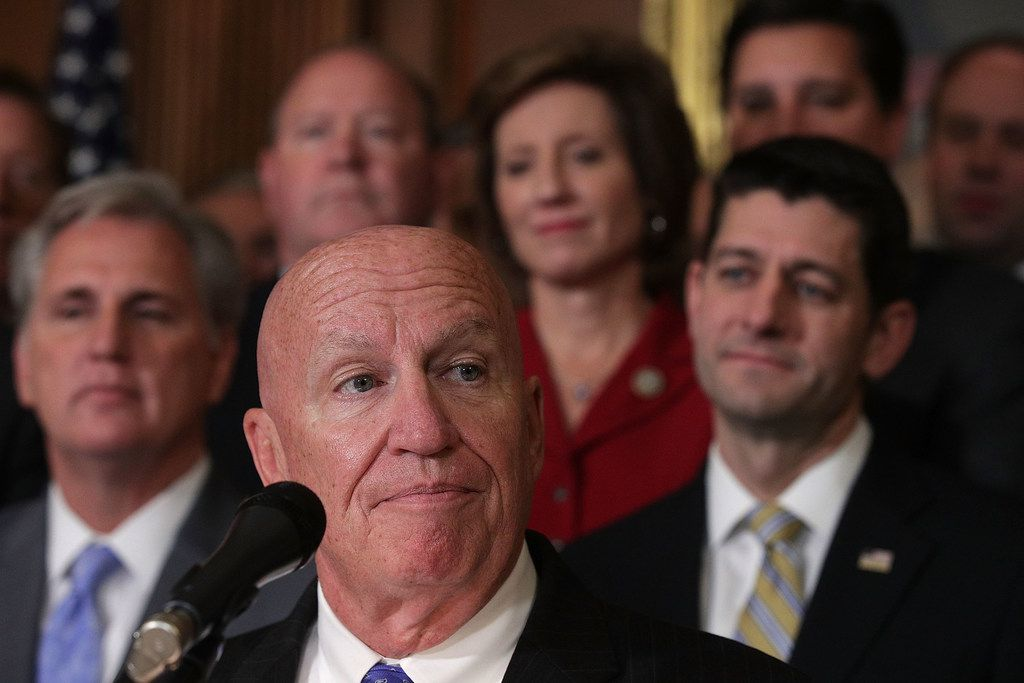 U.S. House Ways and Means Committee Chairman Rep. Kevin Brady, R-The Woodlands, speaks as House Majority Leader Rep. Kevin McCarthy (left) and Speaker of the House Paul Ryan listen during an event at the Capitol to celebrate the passing of the tax reform bill Nov. 16, 2017.
