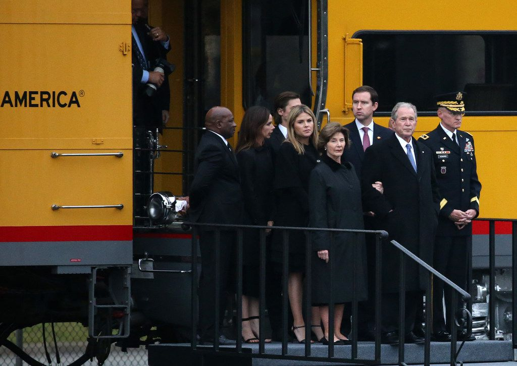 The Bush family, lead by former President George W. Bush and Laura Bush, exits the car of the train carrying the casket of former President George H.W. Bush to his final resting place at the George H. W. Bush Presidential Library Center on Texas A&M University campus in College Station, Texas on Thursday, Dec. 6, 2018.