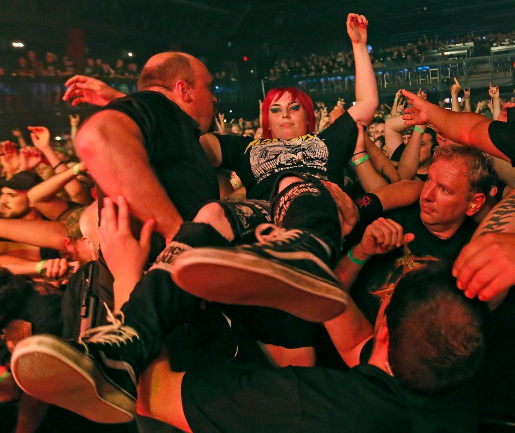 Lamb of God fans crowd surf as the band performs in concert at the Bomb Factory in Dallas, photographed on Tuesday, June 19, 2018. (Louis DeLuca/The Dallas Morning News)