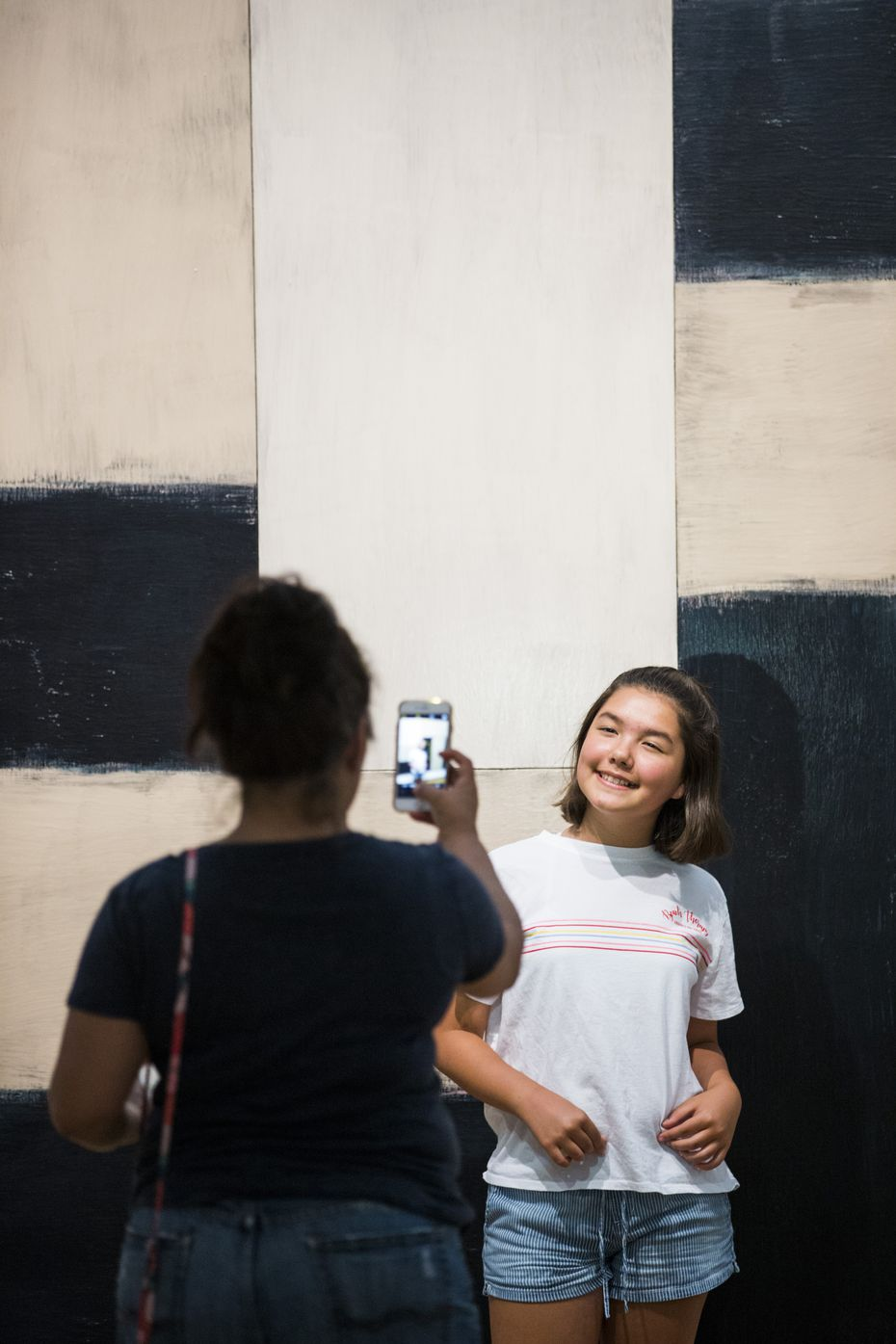 """Hermalinda Idrogo, left, takes a photo of Eva Idrogo, 12, in front of """"Catherine, 1993"""" by Sean Scully at The Modern Art Museum of Fort Worth."""