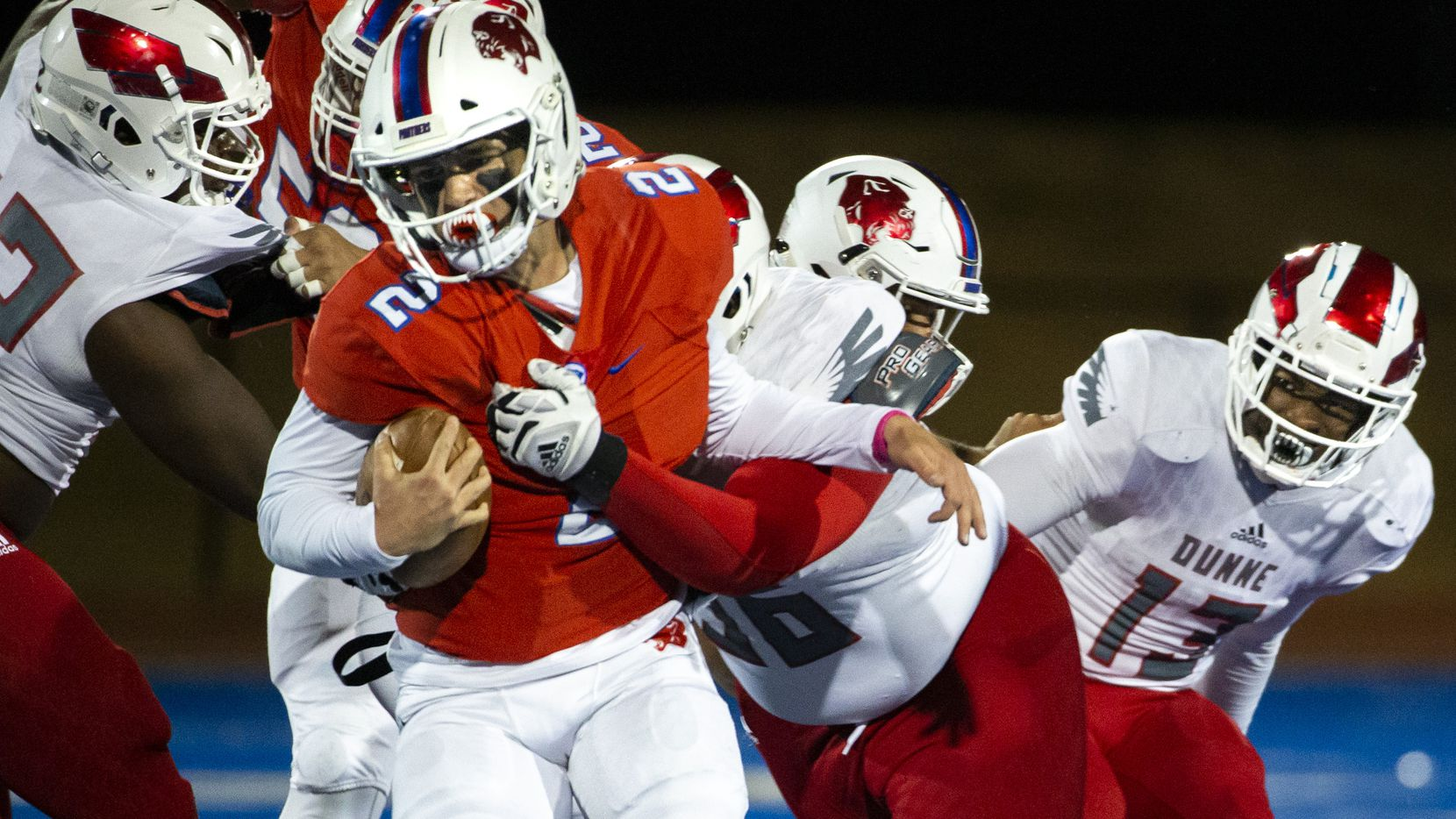 Parish Episcopal quarterback Preston Stone (2) gets taken down by Bishop Dunne defensive lineman Thomas Gort III (56) during the football game between Parish Episcopal High School and Bishop Dunne Catholic School at the Gloria H. Snyder Stadium in Farmers Branch, Texas, on Friday, Oct. 11, 2019.