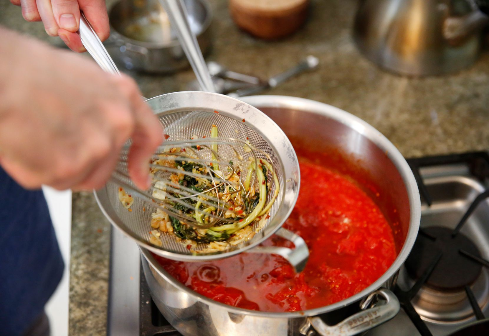 Barsotti adds olive oil infused with basil and garlic to the tomato sauce.