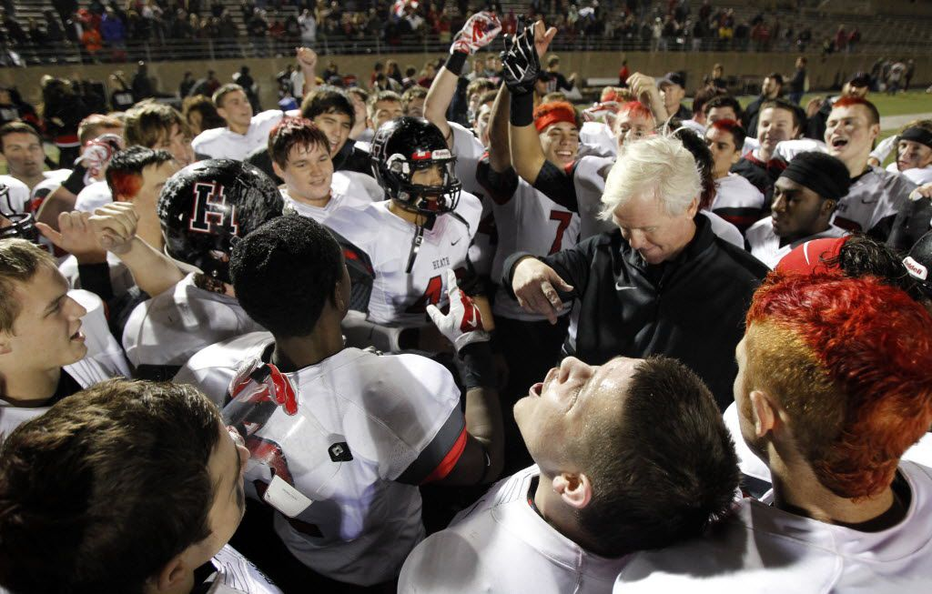 TXHSFB Rockwall-Heath reacts after head coach Mickey Moss speaks after beating Wylie in their 5A Division 1 Region 2 area playoff high school football game at Clark Stadium in Plano, Texas, Friday, November 21, 2014. Mike Stone/Special Contributor