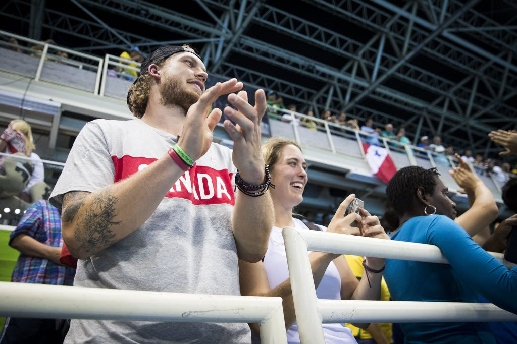 Dallas Stars defenseman Jamie Oleksiak cheers for his sister Penny Oleksiak of Canada after she won the silver medal in the women's 100m butterfly finals at the Rio 2016 Olympic Games on Sunday, Aug. 7, 2016, in Rio de Janeiro. (Smiley N. Pool/The Dallas Morning News)