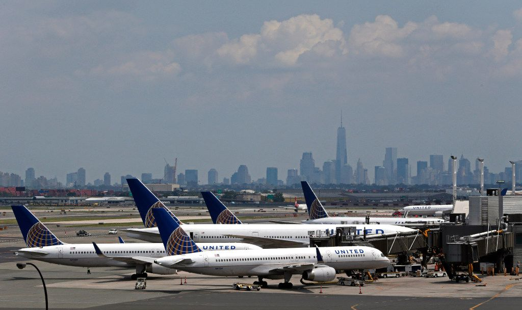 FILE In this July 22, 2014, file photo, United Airlines jets wait at gates at Newark Liberty International Airport in Newark, N.J. (AP Photo/Julio Cortez, File)