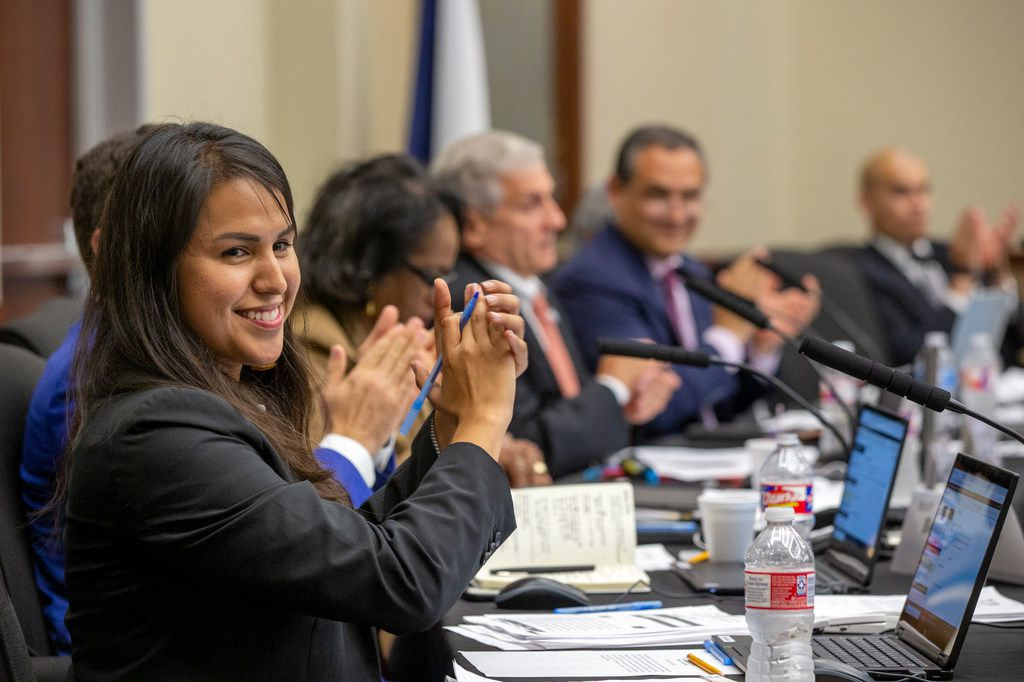 New trustee Karla Garcia applauds along with other trustees during a school board meeting at Dallas ISD's Turney W. Leonard Governance and Training Center in Dallas on June 27, 2019.
