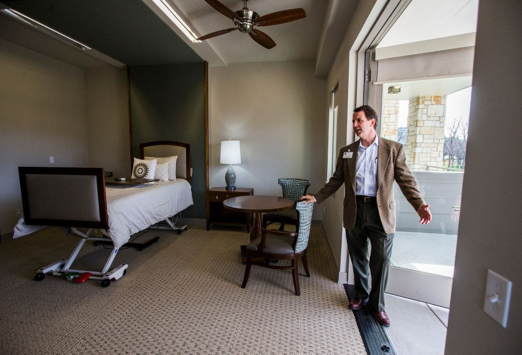 Peter Lynch, executive director of Presbyterian Communities and Services, shows off the balcony inside a patient room at the new T. Boone Pickens Hospice and Palliative Care Center on Tuesday, February 7, 2017 n Merit Drive in Dallas. The facility, which includes the Harold Simmons Inpatient Care Center and the Marnie and Kern Wildenthal Resource and Education Center, is the first free-standing inpatient hospice facility in the greater Dallas area, and is schedule to open around February 15. (Ashley Landis/The Dallas Morning News)