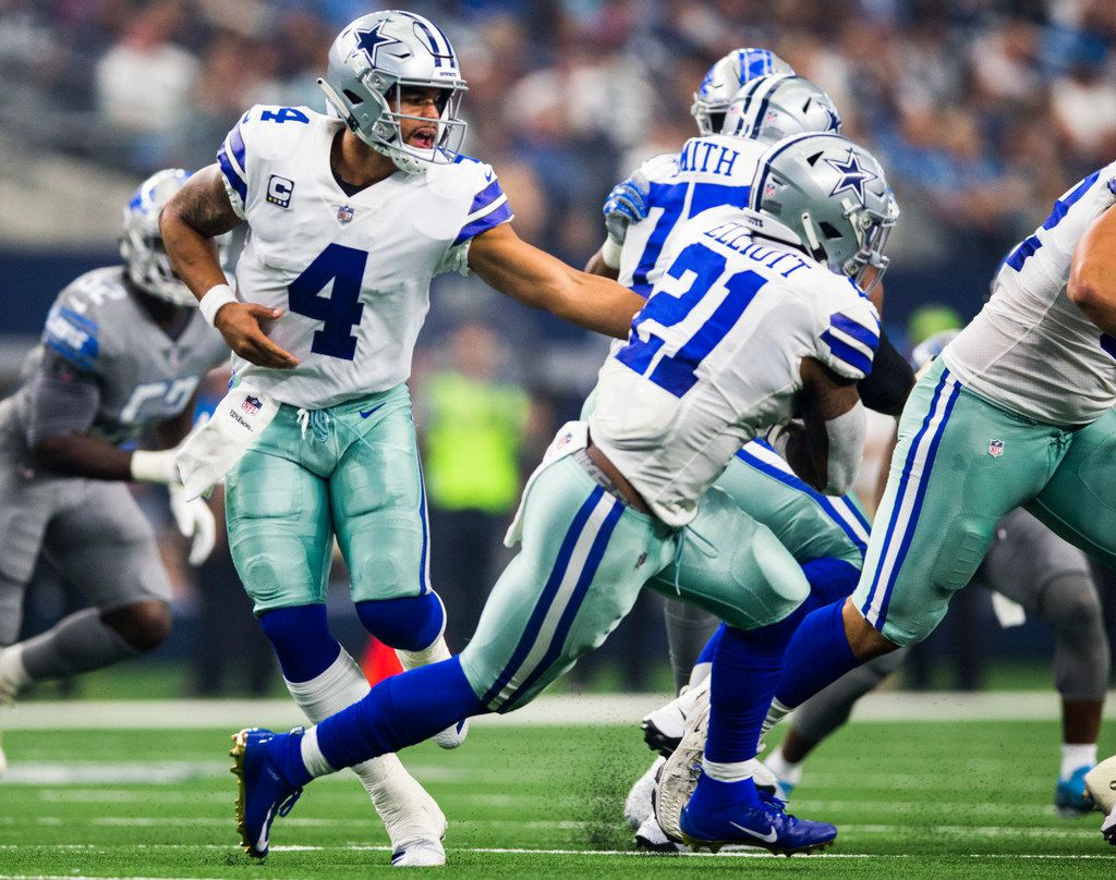 Dallas Cowboys quarterback Dak Prescott (4) hands off to running back Ezekiel Elliott (21) during the second quarter of an NFL football game between the Dallas Cowboys and the Detroit Lions on Sunday, September 30, 2018 at AT&T Stadium in Arlington, Texas. (Ashley Landis/The Dallas Morning News)