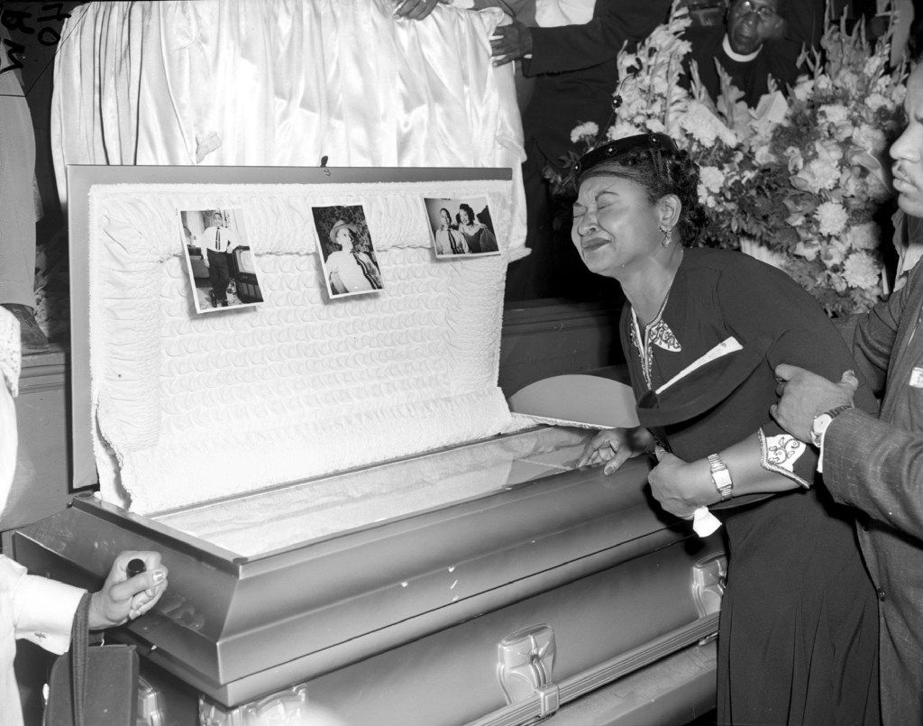 FILE- In this Sept. 6, 1955 file photo, Mamie Till Mobley weeps at her son's funeral  in Chicago.  The woman at the center of the trial of Emmett Till's alleged killers has acknowledged that she falsely testified he made physical and verbal threats, according to a new book. Historian Timothy B. Tyson told The Associated Press on Saturday, Jan. 28, 2017,  that Carolyn Donham broke her long public silence in an interview with him in 2008. (AP Photo/Chicago Sun-Times)   /Chicago Sun-Times via AP)