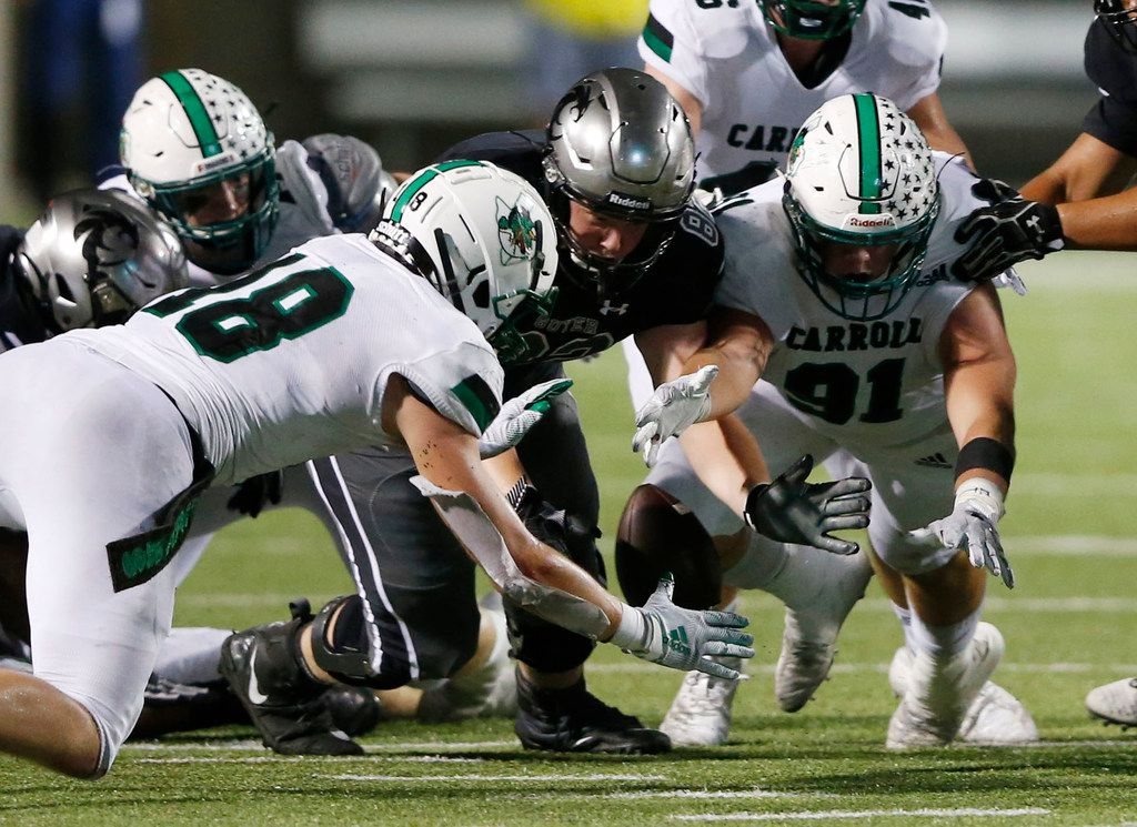 Southlake Carroll's Dillon Springer (91) dives for the fumbled ball and gains possession of it after Denton Guyer fumbled it during the first half of play at C.H. Collins Complex in Denton, on Friday, October 4, 2019. (Vernon Bryant/The Dallas Morning News)