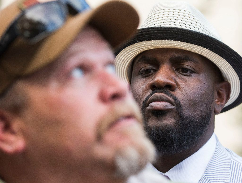Pastor Michael W. Waters looks to counter-protester George Rick, who looks to a Confederate monument, during a rally for removal of Dallas' Confederate monuments and public buildings named for Confederate heroes at Pioneer Park Cemetery in Dallas on Thursday, August 10, 2017. (Ryan Michalesko/The Dallas Morning News)