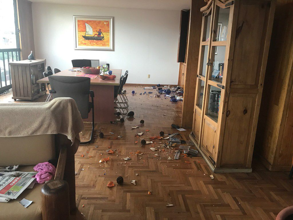 Alfredo Corchado arrived in Mexico City to find debris, broken windows and cracked walls in his home. His apartment survived. Others nearby were not so lucky.