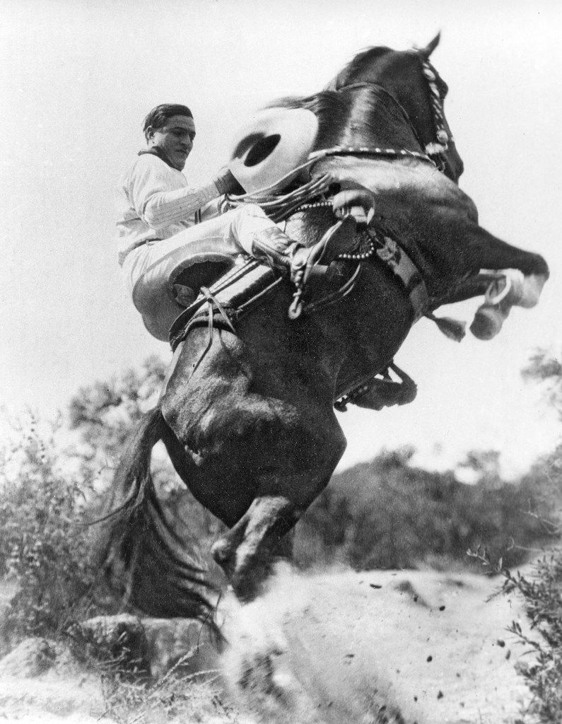 Hollywood western film duo, actor Tom Mix and his horse Tony, perform a stunt on May 1, 1923.
