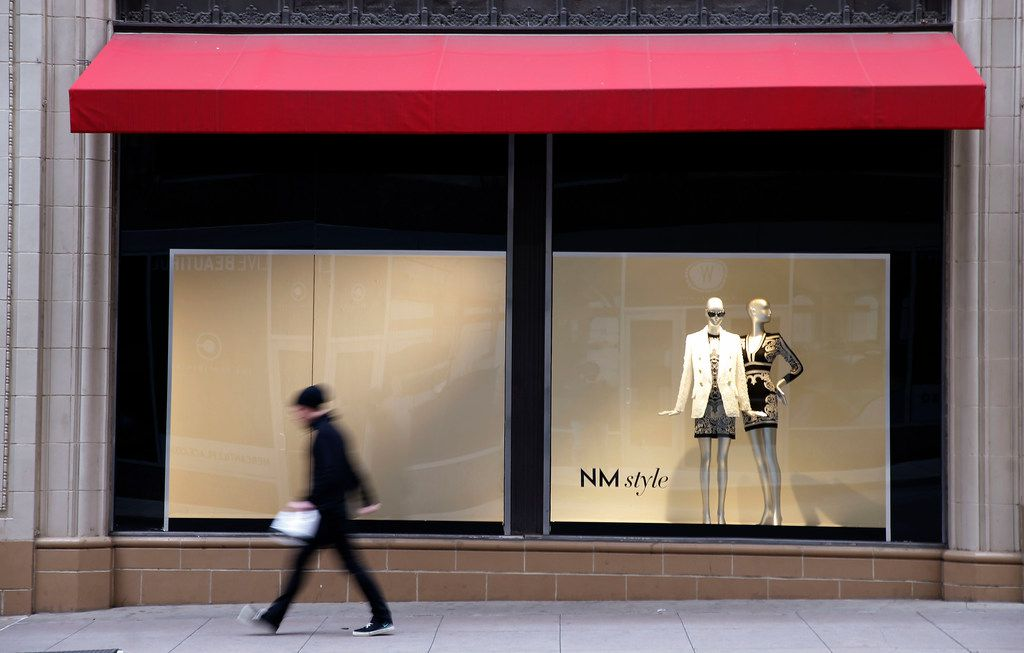 A man walks by the Neiman Marcus store in downtown Dallas.