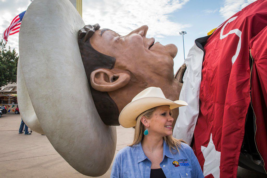 State Fair of Texas vice president of public relations Karissa Condoianis stands next to Big Tex before workers raised him into position in Fair Park on Friday, Sept. 23, 2016, in Dallas. The State Fair of Texas opens on September 30 and runs through October 23. (Smiley N. Pool/The Dallas Morning News)