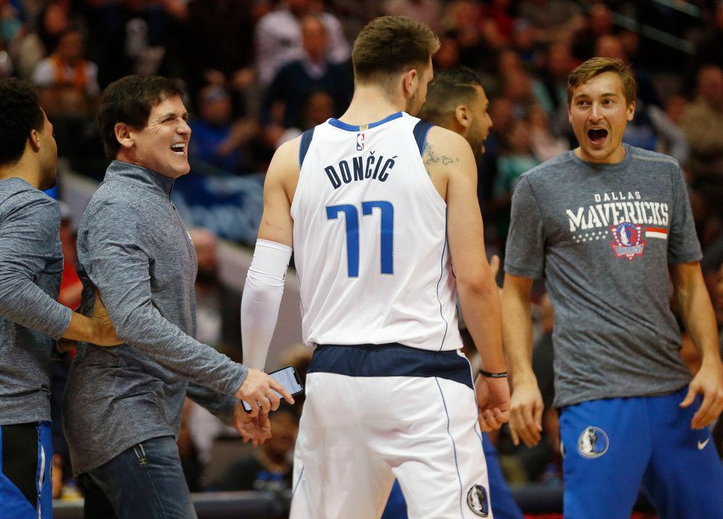 Dallas Mavericks owner Mark Cuban celebrates after Dallas Mavericks forward Luka Doncic (77) made a last second shot to finish the first half in a game against the Utah Jazz at American Airlines Center in Dallas on Wednesday, November 14, 2018. (Vernon Bryant/The Dallas Morning News)