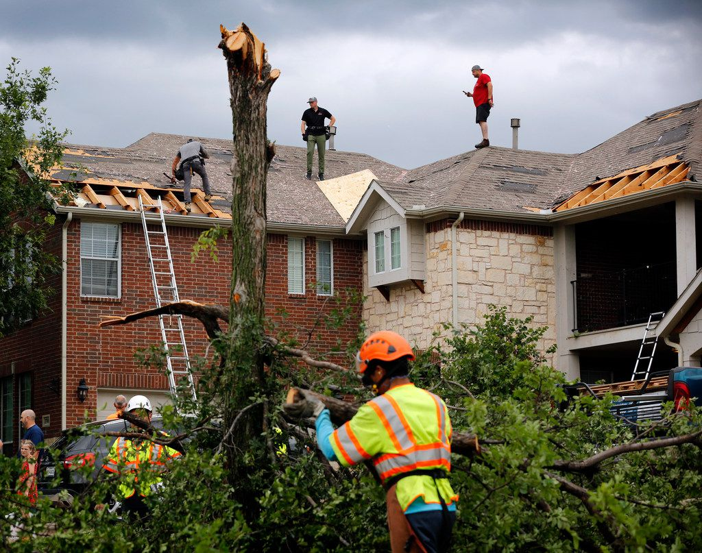 It was a hub of activity on Oliver Drive in the north part of Fort Worth as crews covered damaged rooftops and disposed of splintered trees on Wednesday. A strong storm passed through the neighborhood near Heritage Trace Parkway and North Riverside Drive.