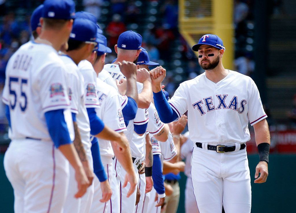 Texas Rangers Joey Gallo (right) is greeted by teammates during player introductions on Opening Day at Globe Life Park in Arlington, Thursday, March 28, 2019. (Tom Fox/The Dallas Morning News)