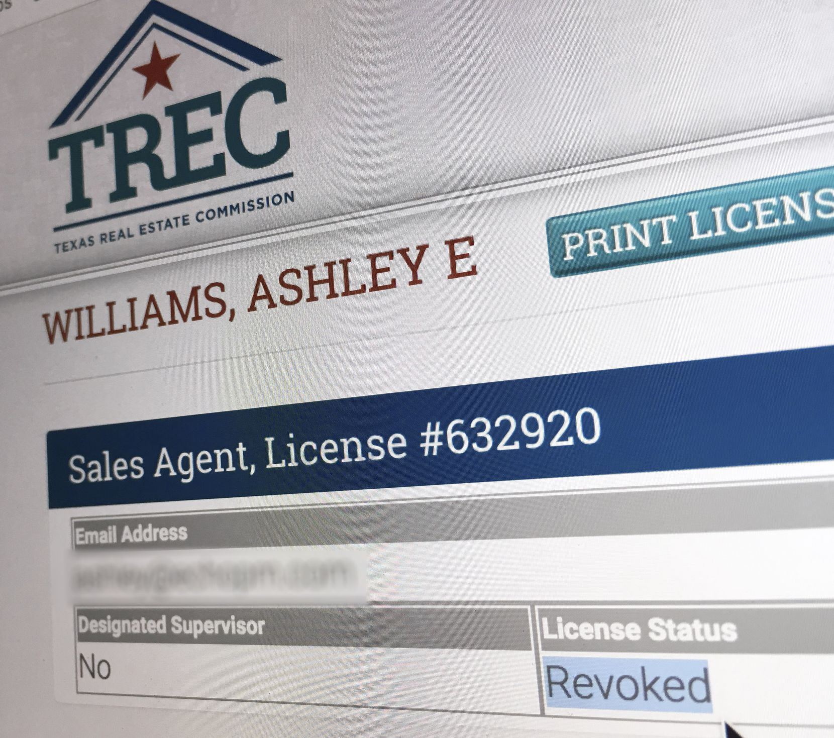 "The Texas Real Estate Commission website lists the real estate license for Ashley E. Williams as ""revoked"". Her email address has been blurred out in this image."