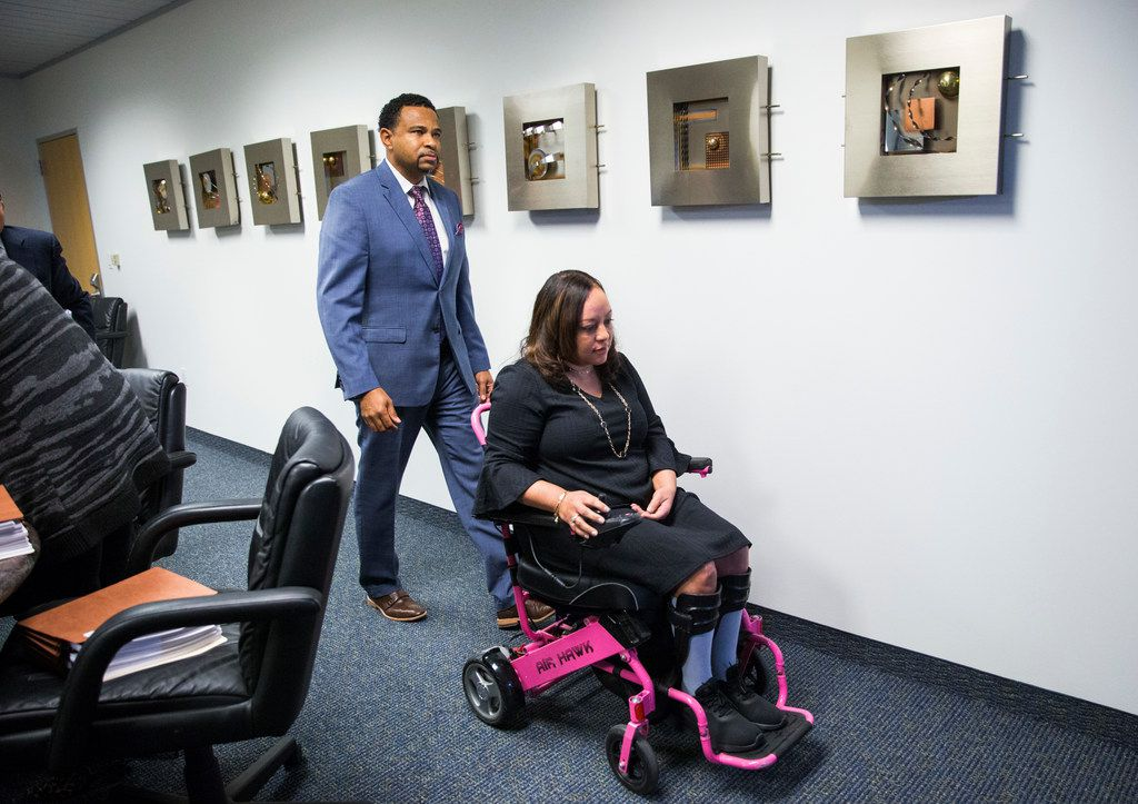 Rolanda Hutton and her husband, Bryan Hutton, leave a news conference on their lawsuit against several Dallas surgeons they hold responsible for her paralysis after cosmetic surgery.