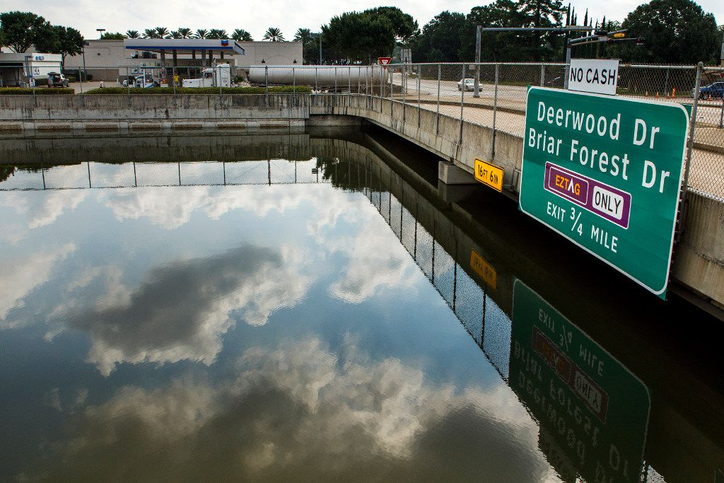 A fuel truck uses the service road as nearly 16 feet of Hurricane Harvey flood water still fills Beltway 8, the Sam Houston Tollway, near Memorial Drive on Monday, Sept. 4, 2017, in Houston.