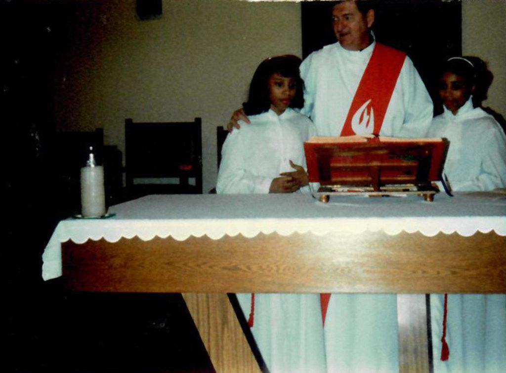 14-year-old Myrna Dartson (left) and her twin Micaela with Deacon Fred Delin at St. Peter the Apostle Catholic Church in Dallas as the girls served as altar servers. Myrna Dartson says Delin helped her and another parishioner bring their complaints to the attention of the Dallas Catholic Diocese.