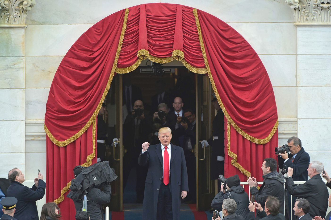 President-elect Donald Trump acknowledges guests as he arrives on the platform at the US Capitol in Washington, DC, on January 20, 2017, during his swearing-in ceremony. /