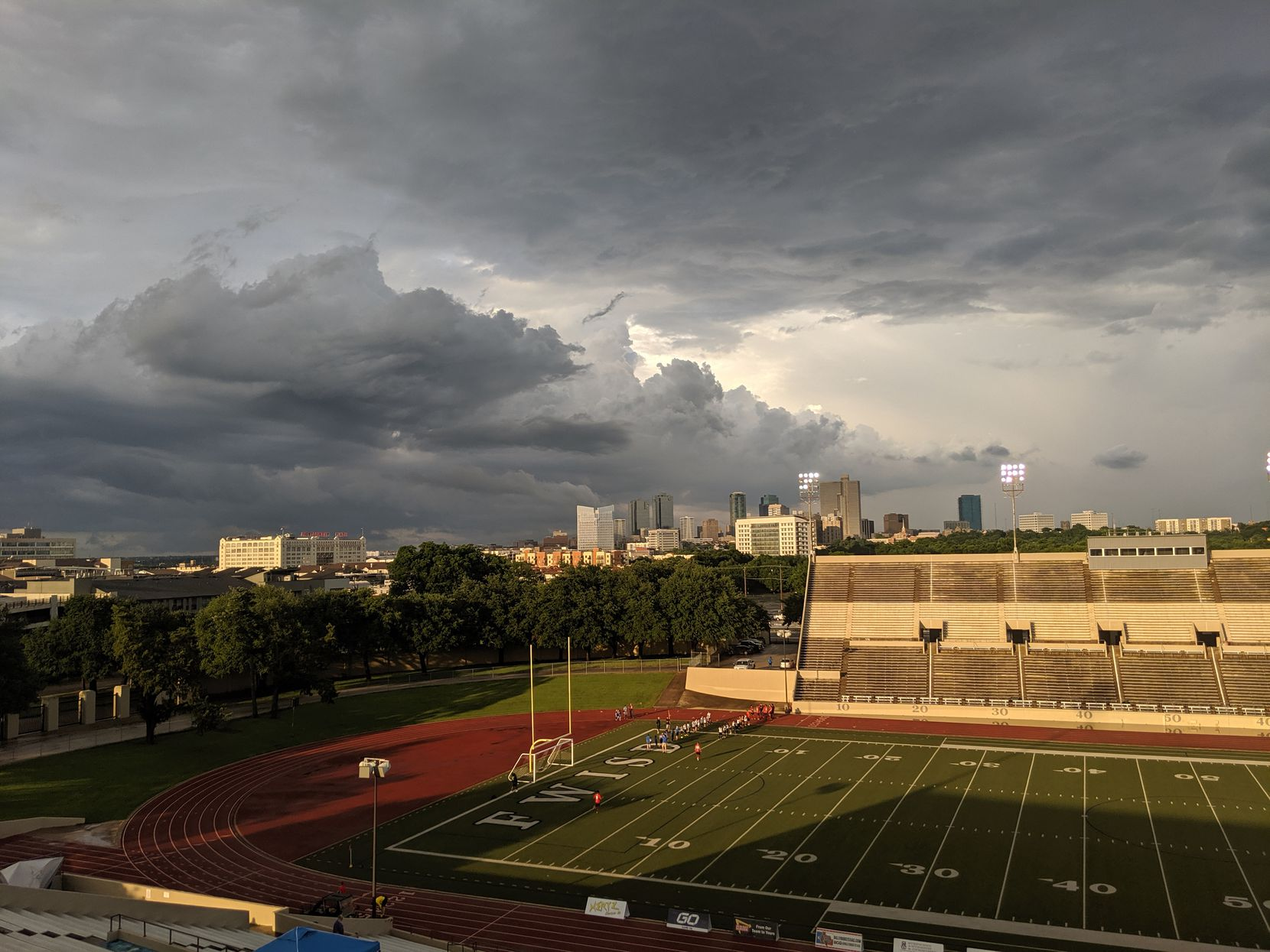 A brief moment of sunshine as storm clouds loom over the city prior to the Chisholm Trail Clásico between Fort Worth Vaqueros and Denton Diablos at Farrington Field in Fort Worth, Texas. (6-1-19)