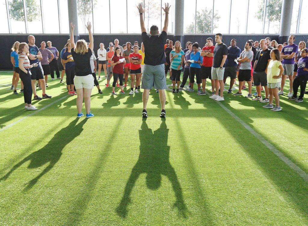 Adam Annaccone, director of performance health care education and research at Baylor Scott & White Sports Therapy and Research at The Star, instructs Frisco ISD physical education teachers as they learn new warm-up routines for elementary, middle and high school students on Thursday at the Baylor Scott & White Sports Performance Center at the Star in Frisco. (Louis DeLuca/The Dallas Morning News)