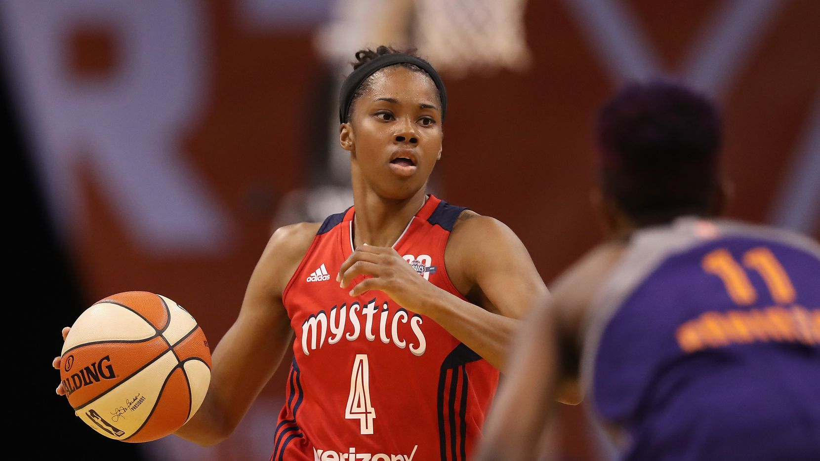 PHOENIX, AZ - JULY 05:  Tayler Hill #4 of the Washington Mystics handles the ball during the WNBA game against the Phoenix Mercury at Talking Stick Resort Arena on July 5, 2017 in Phoenix, Arizona.  NOTE TO USER: User expressly acknowledges and agrees that, by downloading and or using this photograph, User is consenting to the terms and conditions of the Getty Images License Agreement.  (Photo by Christian Petersen/Getty Images)