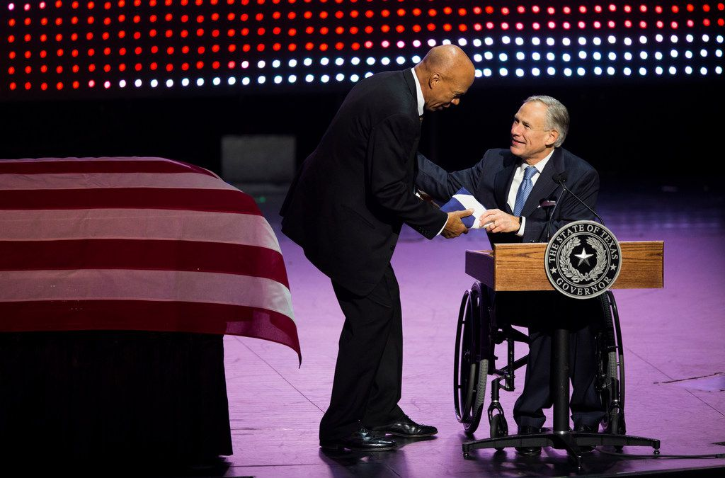 Governor Greg Abbott makes a presentation to Volma Overton, Jr. during a memorial service for Richard Overton on Saturday, Jan. 12, 2019, at Shoreline Church in Austin. Overton was the oldest living veteran and oldest living male at 112 years old until he died on Dec. 27, 2018. He was known for drinking whiskey and smoking cigars on his front porch in East Austin. Volma Overton was a cousin and the main caretaker for Richard Overton.